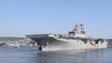 USS Bonhomme Richard Departs Fleet Activities Sase...